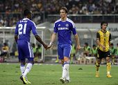 BUKIT JALIL, MALAYSIA - JULY 21: Chelsea's Kalou (21) speaks to Fernando Torres off the ball in this match against Malaysia in the National Stadium on July 21, 2011 in Bukit Jalil, Malaysia. Chelsea won 1-0.
