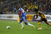 BUKIT JALIL, MALAYSIA - JULY 21: Chelsea's Nicolas Anelka (L) takes on a Malaysian defender in a friendly match at the National Stadium on July 21, 2011 in Bukit Jalil, Malaysia. Chelsea won 1-0.
