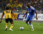 BUKIT JALIL, MALAYSIA - JULY 21: Chelsea's Nicolas Anelka (R) takes on a Malaysian defender in a friendly match at the National Stadium on July 21, 2011 in Bukit Jalil, Malaysia. Chelsea won 1-0.