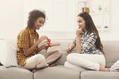 Excited Woman Getting Gift From Her Girlfriend. Two Happy Female Friends Exchanging Presents, Copy S poster