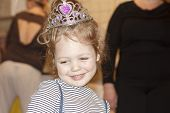 Portrait Of Joyful Little Girl With Cake At Birthday Party . Holidays Concept. Portrait Closeup Of A poster