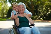 Senior Woman In Wheelchair Holding Thumbs Up