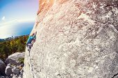 A Rock Climber On A Wall. poster