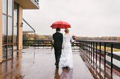 Young Couple Under Umbrella In The Autumn On Rainy Day Weather. Lovely Couple In Love With Umbrella  poster