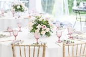 Beautiful Table Setting With Crockery And Flowers For A Party, Wedding Reception Or Other Festive Ev poster