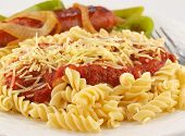 Rotini Pasta With Tomato Sauce, Cheese, And Sausage With Peppers And Onions