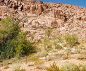 foto of split rail fence  - A split rail fence spanning a desert in front of mountains - JPG