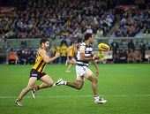 MELBOURNE - SEPTEMBER 9 : Travis Varcoe (r) in action during Geelong's win over Hawthorn - September 9, 2011 in Melbourne, Australia.