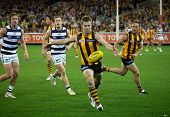 MELBOURNE - SEPTEMBER 9 : Sam Mitchell (C) in action during Geelong's win over Hawthorn - September 9, 2011 in Melbourne, Australia.