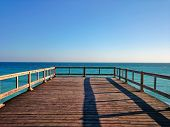 Wooden Terrace Dock Or Pier. Wooden Dock   (pier) Blue Sea And Sky Background. View Of Wooden Pier O poster
