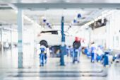 Blurred Background : Car Technician Repairing The Car In The Shop, Garage Or Service Station. poster