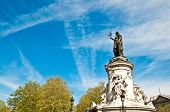 The Famous Statue of the Republic in Paris looking away in the blue sky. built in 1880 in the center
