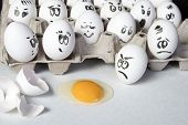 The Hen Eggs In Box. Eggs Cover With Drawings. Look Like Man Face. Indignant Eggs Look At The Broken poster