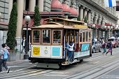 SAN FRANCISCO - AUG 20: Passengers enjoy a ride in a cable car on August 20, 2011 in San Francisco.