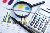 Calculator On Chart And Graph Paper. Finance Development, Banking Account, Statistics, Investment An poster