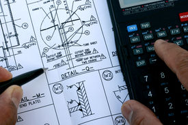 foto of mechanical engineer  - Mechanical Engineer checked his drawing dimension with calculator - JPG