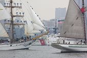HOBOKEN, NJ - MAY 23: USCGC Seneca (WMCE 906) sails past two tall ships on the Hudson River during t