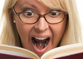 Excited Woman Is Stunned Reading A Book