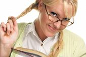 Shy Female Plays With Ponytail & Reads Her Book