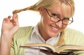 Flirty Female Plays With Ponytails & Reads Her Book
