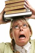 Frightened Woman With Stack Of Books
