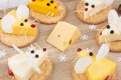 Tasty Food For Chinese New Year Of The White Rat. Mice Shaped Cheese Appetizer. Festive Mood. Close- poster
