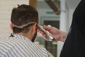 Close Up Shot: Barber Working With Hair Clipper. Hipster Client Getting Haircut. Haircut, Styling Co poster