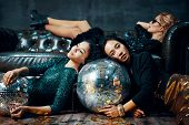 Crazy Party. Pretty Multiethnic Young Women Relaxed After Party, Lying Down On The Floor And Sofa. C poster