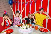 Very emotional little girl rejoice  in her birthday round about her friends
