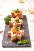 festive canape with gingerbread cake, foie gras and salmon poster