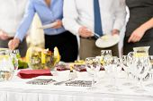 Business catering people serving themselves buffet at company meeting