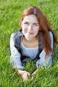 image of shepherdess  - Nice medieval woman laying on the grass - JPG
