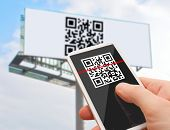 stock photo of qr-code  - Reading of QR Code from Billboard with Smartphone - JPG
