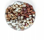 Healthy Food. Nuts Mix Assortment On White Grey Table Top View. Collection Of Different Legumes For poster
