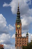 Clock Tower Of Old Historic Brick Town Hall In Gdansk Old Town, Poland Against Cloudt Sky With Copy  poster