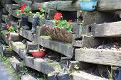railroad ties fence flower garden