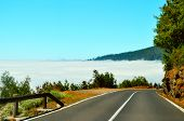 Mountain Highway Road In Cloud. Landscape Rocks, Sunny Sky, Clouds & Beautiful Asphalt Highway Road  poster