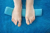 Pedicure, Bare Feet. Female Feet Without Retouching. Female Feet On A Blue Background. Natural Photo poster