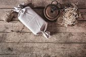 Flatlay, Ecologically And Sustainably Method To Wrapping A Gift On Wooden Background, Copyspace poster