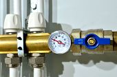 Close Up Of Manometer, Pipe, Flow Meter, Water Pumps And Valves Of Heating System In A Boiler Room A poster