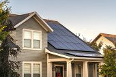 Solar Photovoltaic Panels On A House Roof poster