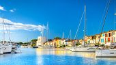 View Of Colorful Houses And Boats In Port Grimaud During Summer Day-port Grimaud, France poster