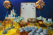 ?akes and candys with castle and crowns on plate at birthday party. Anniversary, celebration and fes poster