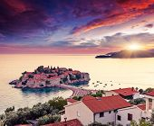 Sveti Stefan, small islet and resort in Montenegro. Overcast sky. Balkans, Adriatic sea, Europe. Bea