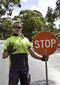 Road worker controls traffic flow