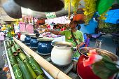 PAI, THAILAND - JAN 2: Street vendor in Pai on Jan 2, 2013 in Pai, Thailand. During high season, tou