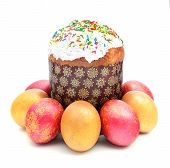 Easter Cake With Sugar Glaze And Painted Eggs Isolated On White