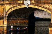 Boat on Arno river in Florence, Italy