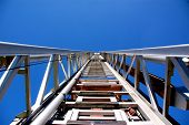 stock photo of ladder truck  - Upside view on a silver ladder of a fire brigade - JPG