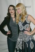 BEVERLY HILLS - MARCH 14:  Kat Dennings and Beth Behrs arrive at the 2013 Paleyfest